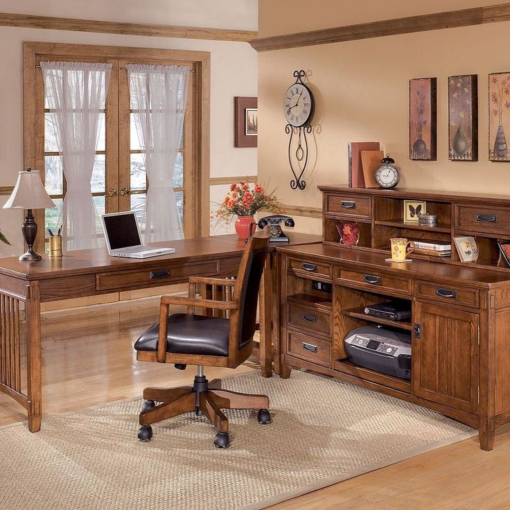 That Furniture Outlet - Minnesota's #1 Furniture Outlet. We have exceptionally low everyday prices in a very relaxed shopping atmosphere. Ashley Cross Island - Large Leg Desk Corner Table Credenza with Short Hutch & Swivel Chair thatfurnitureoutlet.com #thatfurnitureoutlet  #thatfurniture  High Quality. Terrific Selection. Exceptional Prices.