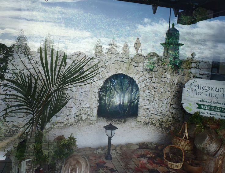 This is our first window display. Love the way the lighthouse across the road is reflected in leaves. The display focuses on the use of pressed leaves for decorative purposes, and you can find our little nutters tucked away in cosy bird's nest (an old one that had blown to the ground), and baskets of nuts and cones.