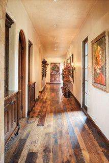 *I like the multi-shade floor panels.* Light, cream-colored walls accentuate the lighter shades in the flooring, bringing an overall lightness to an otherwise dark hallway.