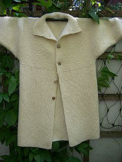 An interestingly constructed, garter stitch coat with minimal finishing.