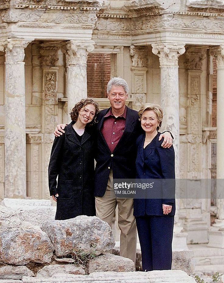 US President Bill Clinton stands in front of the ruins of Library of Celsus constructed in 117 A.D. with First Lady Hillary and their daughter Chelsea 17 November 1999 in Seleuk. The Clintons are spending the afternoon visiting the archeological site uncovering the ancient city of Ephesus.