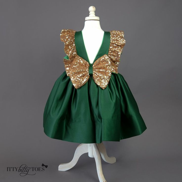 Treat her like the rare gem that she is with the emerald green Esmeralda Dress. You will love the rich emerald satin and gold sequin accents. It has a vintage p