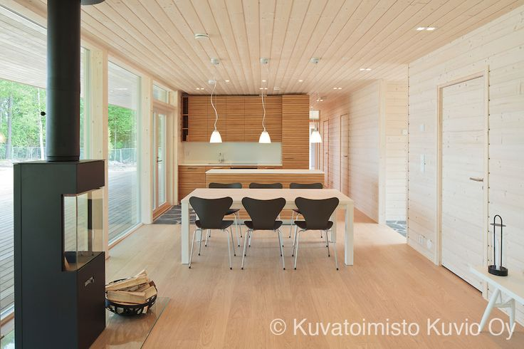 Interior of Plushuvila. Plushuvila is a wooden villa in Mäntyharju, Finland. It's designed by Plusarkkiethdit.