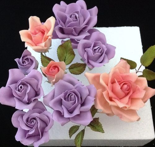 Large Rose Tutorial - by Cakeage @ CakesDecor.com - cake decorating website -- good tutorial and I love the technique used for the last row of wired petals.