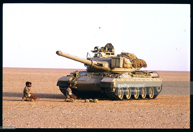 Allied Arab Forces during the Gulf War gathered their troops in the area where the borders between Iraq, Saudi Arabia and Kuwait meet. Pictured here is an AMX 30 tank stopped in the middle of the desert during a maneuver for religious reasons. The crew is praying to Mecca.   Location: Nafar Al Batin, Saudi Arabia.