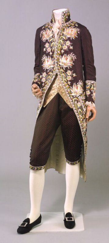 Gentleman's court suit Date: 1780–1785 Media: Silk Brocade, Polychrome Silk Embroidery Country: England Accession Number: 1982.4a-b Court suit consisting of coat and breeches. Black silk figured with purple circles and elaborate floral embroidery