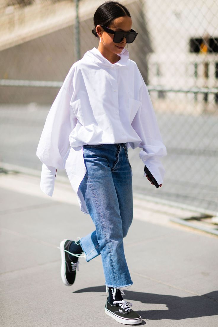 oversized and extended white shirt outfitted with cut off boyfriend jeans and casual sneakers    Saved by Gabby Fincham   