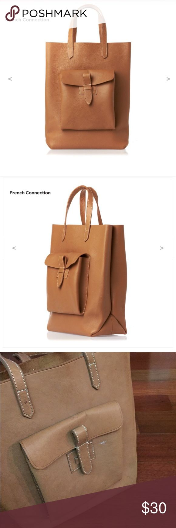French Connection Shopper Tote 100% Leather 100% Leather super durable. Minor imperfections. Has a lot of life left!!!! I'm sure a shoe repair place or Leather Spa can fix the markings for a reasonable price. French Connection Bags