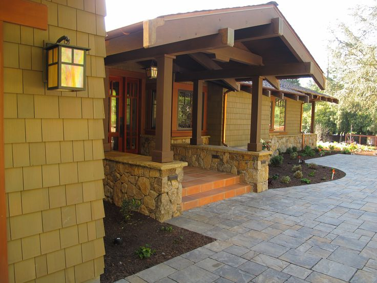Classic Craftsman style using Shakertown's Tahoe Shingle Panel pre-finished in Pasadena Green semi-solid stain.
