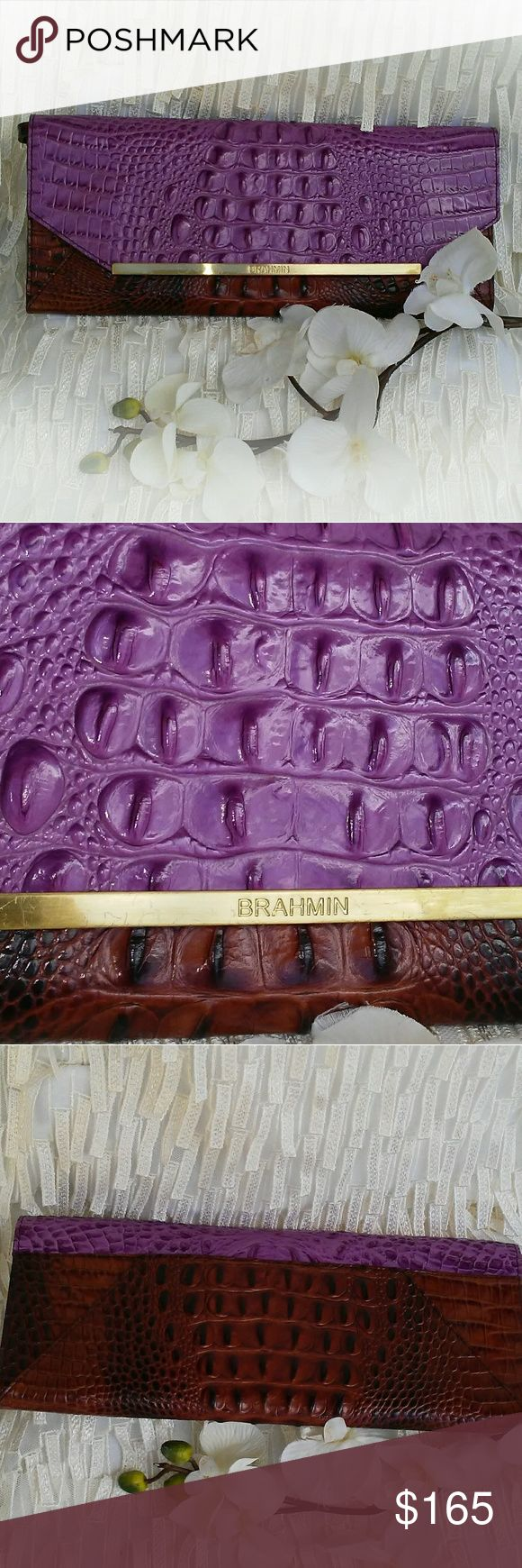 """Brahmin 'Alexis' Clutch Absolutely stunning Brahmin 'Alexis' clutch. This bag is sleek, super chic and perfect for every occasion. The beautiful lavender and brown combination enlivens the crocodile- embossed clutch. This bag has detachable shoulder strap (12"""" to 14"""" drop).  13""""L x 5.5""""H x 1.5""""W. Interior has one zip pocket, key clip and signature Brahmin lining. Exterior has magnetic flap closure. This bag has never been carried and is in perfect condition! (as seen in photos) Definitely a…"""