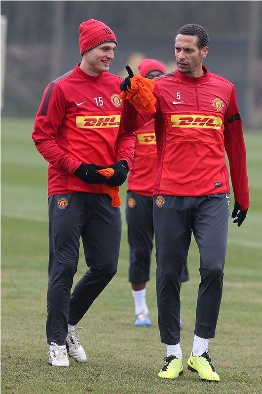 Manchester United look set to field Rio Ferdinand and Nemanja Vidic at Arsenal with Phil Jones moving into midfield.
