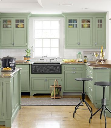 A Lovely Pastel Kitchen via Country Living Magazine  Use a farmhouse table (or DIY the farmhouse table look), vintage antiques, and country pastel colors (sage, cream, pale blue) to capture the essence of country decorating. A little warm colored wood in the kitchen will also help give off the country farm vibe.  Hometalk