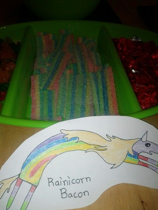 Adventure Time party: Rainicorn Bacon: I used sour candy rainbow strips and drew the picture myself :)