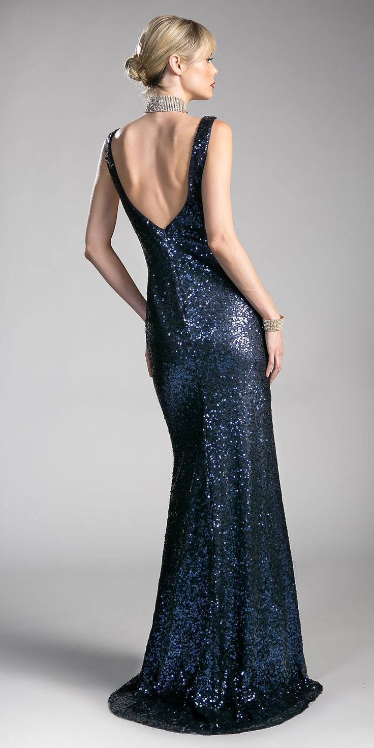 Enjoy the night with this fashion forward sequins floor length prom dress by Cinderella Divine CR802 in navy blue. Fit and flare style this long prom dress has plunging v-neck with sheer inset and sheer panel details on the side establishing a perfect figure. This shimmering formal dress with v-shape open back is a perfect outfit for prom, red carpet events or any formal events. Designer: Cinderella Divine Item number: CR802 Material: Sequins Back zipper. Fully lined. Soft cup inserts. ...