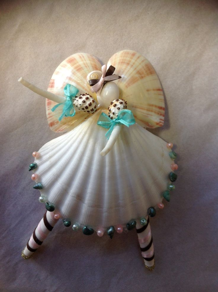 Handmade Nutcracker Sweet Ballerina Seashell Angels are so fun Dancing. Each Angel has a Large White Scalloped Seashell. Arms are Dentalium (a kind of worm Shell), Her face is a white moon snail. The