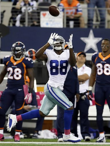 Dallas Cowboys wide receiver Dez Bryant makes an 80-yard reception from Tony Romo during the fourth quarter of an NFL football game against ...