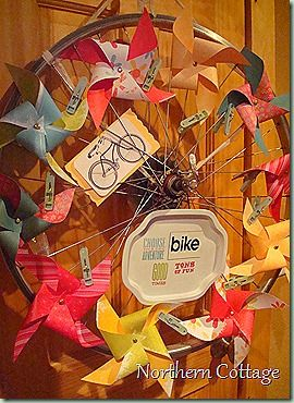 pinwheel bicycle wreath....or how about whatever interests you?  Flowers...cookie cutters....photographs...sewing tools.....hmmm....
