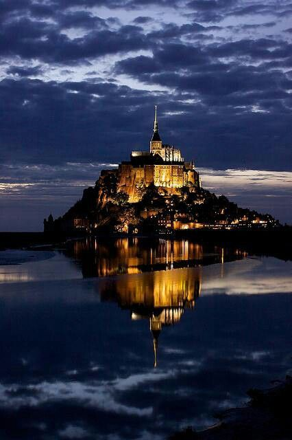 Mont Saint-Michel, France.     You can hear the hoofbeats of knights on horseback echoing through the narrow streets..  The king's fleet with full mast is just barely visible on the horizon. And the sound of monks whispering vespers by candlelight  fills the air at sunset.