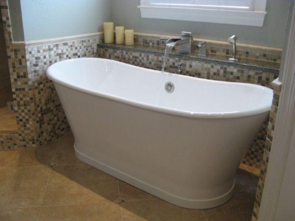 bathrooms with freestanding tubs | Traditional bathroom featuring a freestanding tub with adjacent shelf ... #Bathtubs