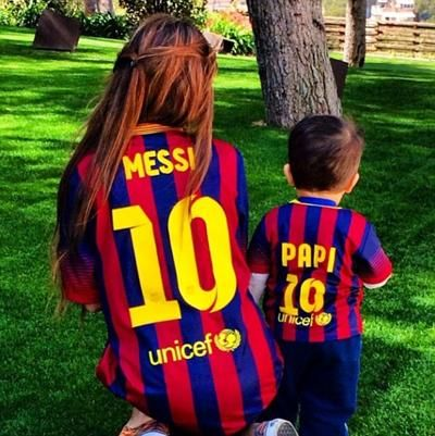 Messi's girlfriend Antonella Roccuzzo and son Thiago Messi supporting him with FC Barcelona jerseys