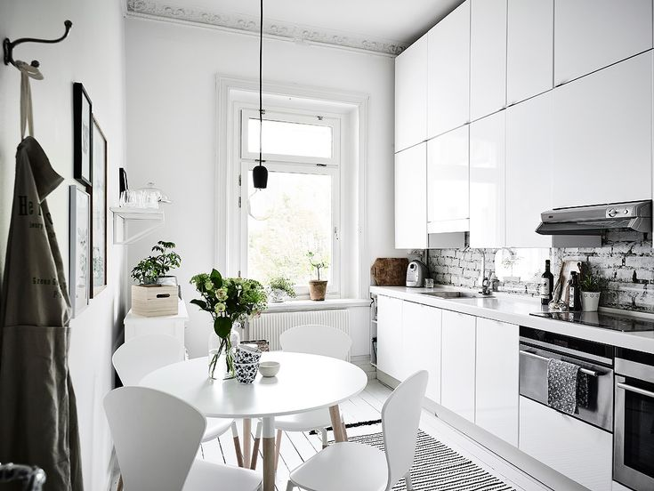 White kitchen with exposed brick