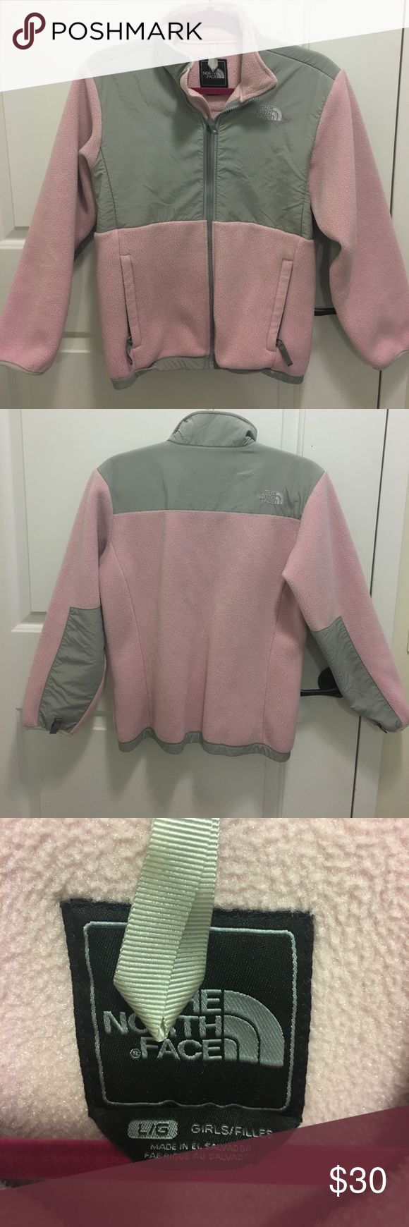 The North Face - Girls pink and grey zip up fleece Girls North Face fleece jacket size Large (12-14). Gently worn. The North Face Jackets & Coats