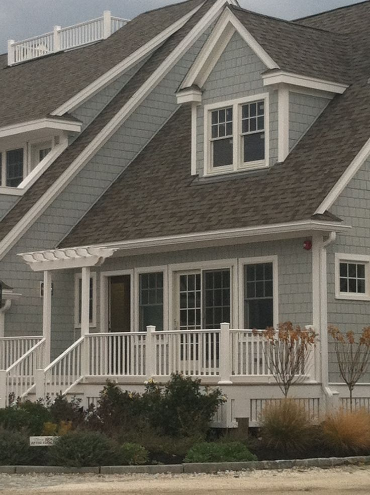 Attractive New England. Cape Cod Architecture. Dormers. Cornice Returns. High Peak Roof .