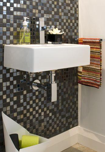 Mosaics add glamour to this Powder Room #mosaictiles #tiles #powerroom #green #missoni #colouredtoiletrolls #interiors #bathroom #design #interiordesign