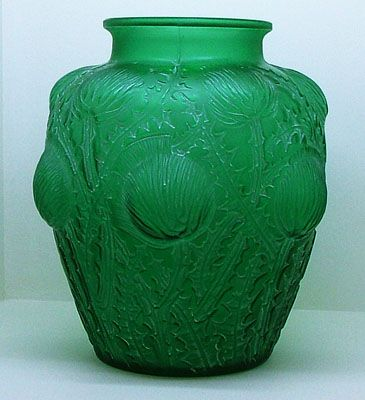Rene Lalique. DOMREMY A very nice example in bright emerald green glass with white patina.The design is of flowering thistles, the symbol of Nancy France. Date c 1935.