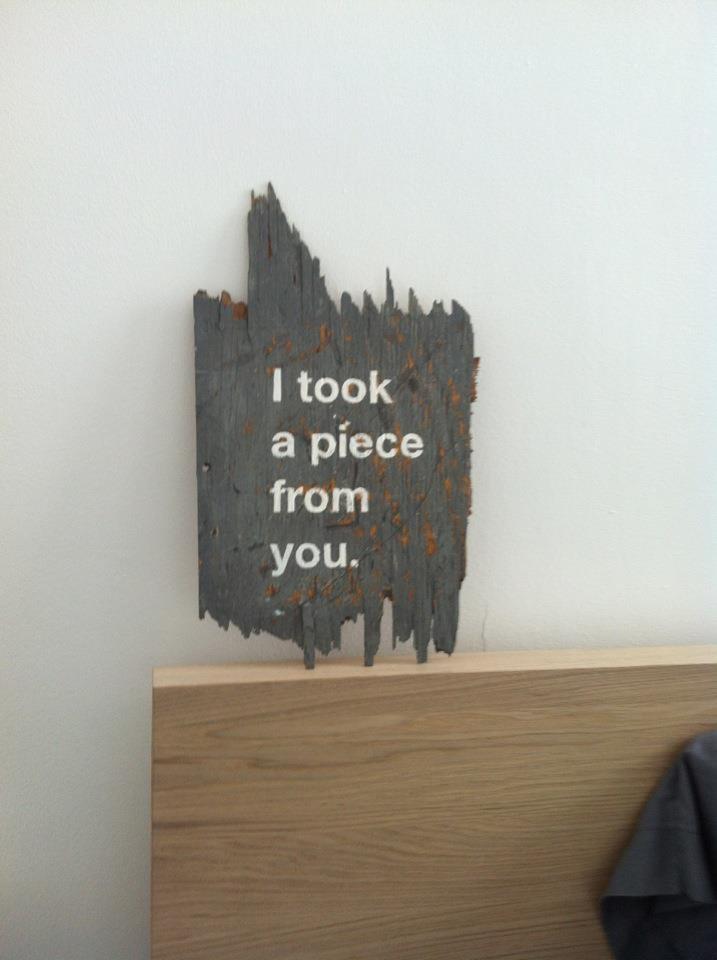 Driftwood art in bedroom.
