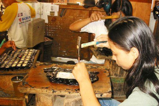 Rare skill: Marni, 25, from Kotagede, Yogyakarta, applies herself to making jewellery, in Salim Silver's workshop, in Oct. 2009.  JP/Yuliantoro