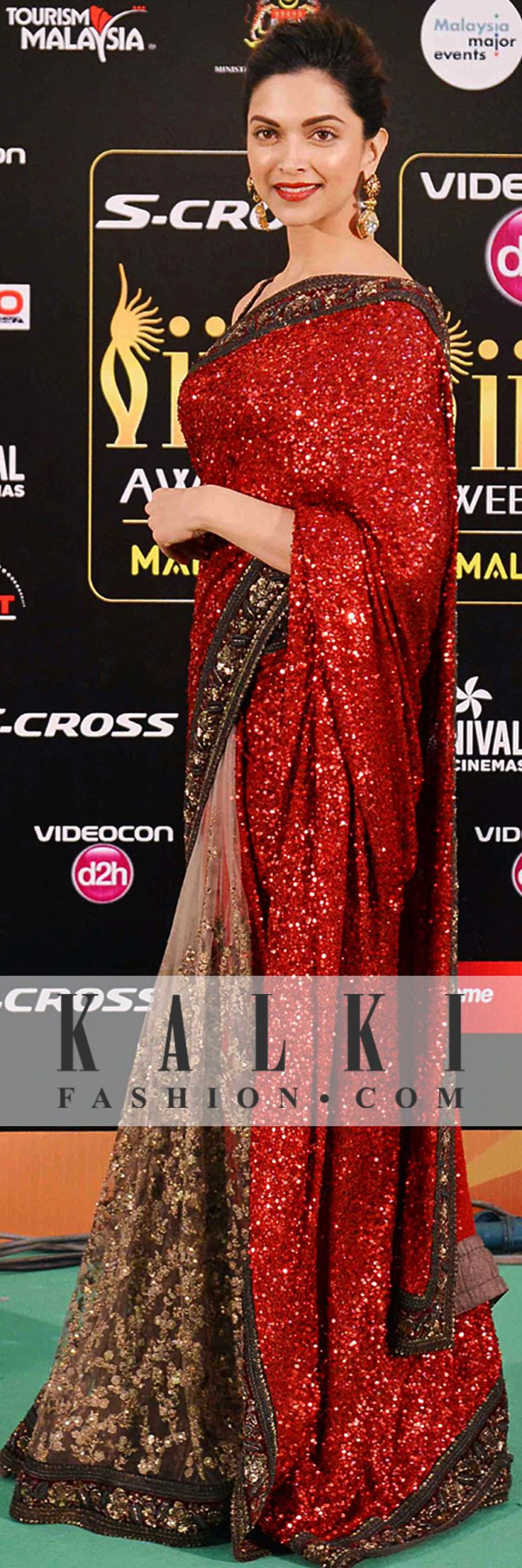 Deepika Padukone: The tall tower of Bollywood was seen dazzle in a red and golden shimmer saree. She carries herself and everything she wears with grace and confidence