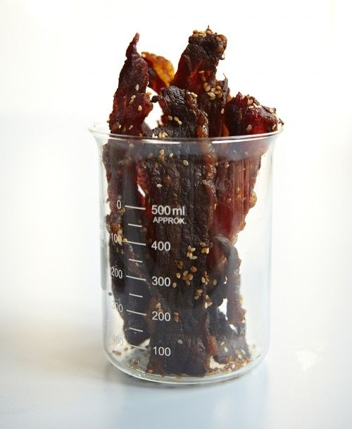 homemade beef jerky in measuring glass