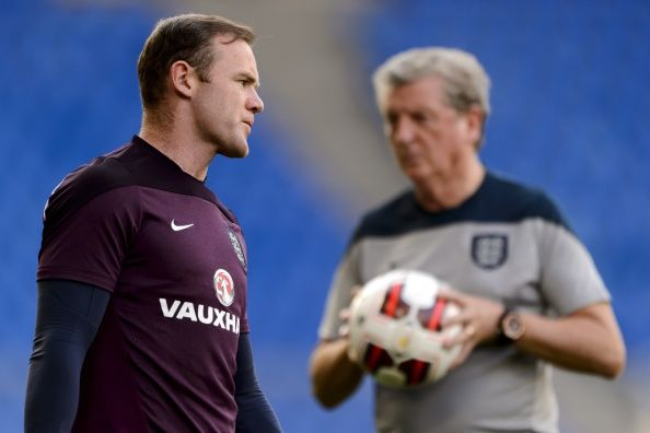 England forward Wayne Rooney (L) gestures near manager Roy Hodgson on September 7, 2014 during a training session at the St. Jakob-Park stadium in Basel on the eve of the UEFA Euro 2016 qualifying football match between Switzerland and England.