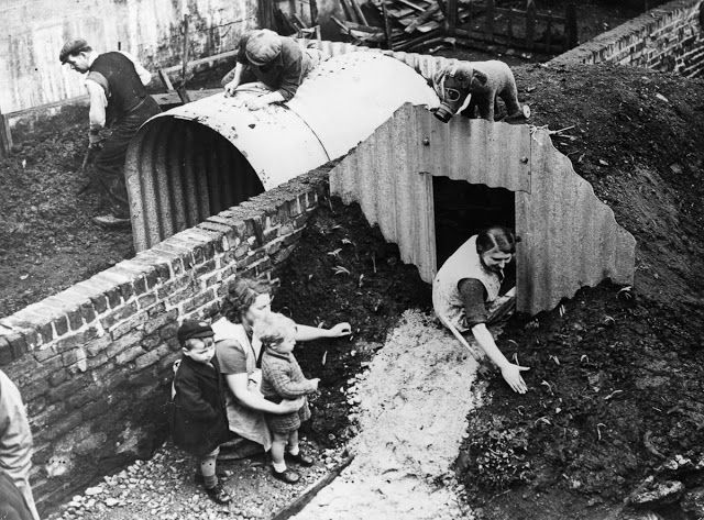 Neighbors assemble Anderson shelters in their backyards, 1940.