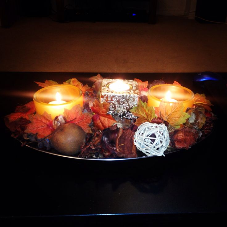 #fall #decor #cheap #DIY fall decor for under 10$ super easy and for a candle lover a perfect center piece ! Everything was purchased from a dollar store. A silver colored platter, fake leaves, two orange candle holders one tall gold/silver tea light holder and a bag of fall inspired potpourri smells like cinnamon and nutmeg! Everyone loves it. And so easy to #doityourself !