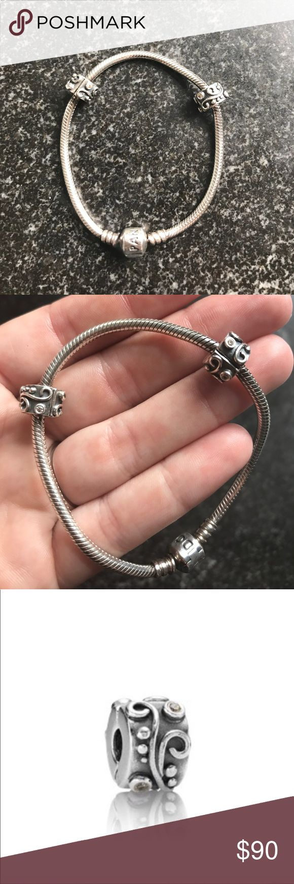 PANDORA BRACELET WITH TWO SPACERS SIZE 7.5 19CM Selling this Pandora bracelet with two spacers. Spacers with crystal detail are discontinued and each retailed for $40. Bracelet is size 7.5 or 19cm and the retail price on that was $65. Item was cleaned professionally at the Pandora store on 6/9/2017. Pandora Jewelry Bracelets