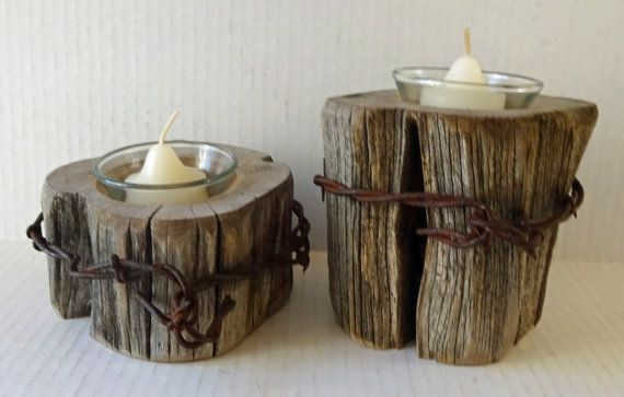 Great pair of rustic candle holders, made from a barbed wire fence posts. Holders stand 4.5 tall and 2.5 tall and 4.5 in diameter. Candles included.