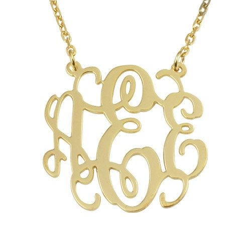 monogram necklace in yellow gold.
