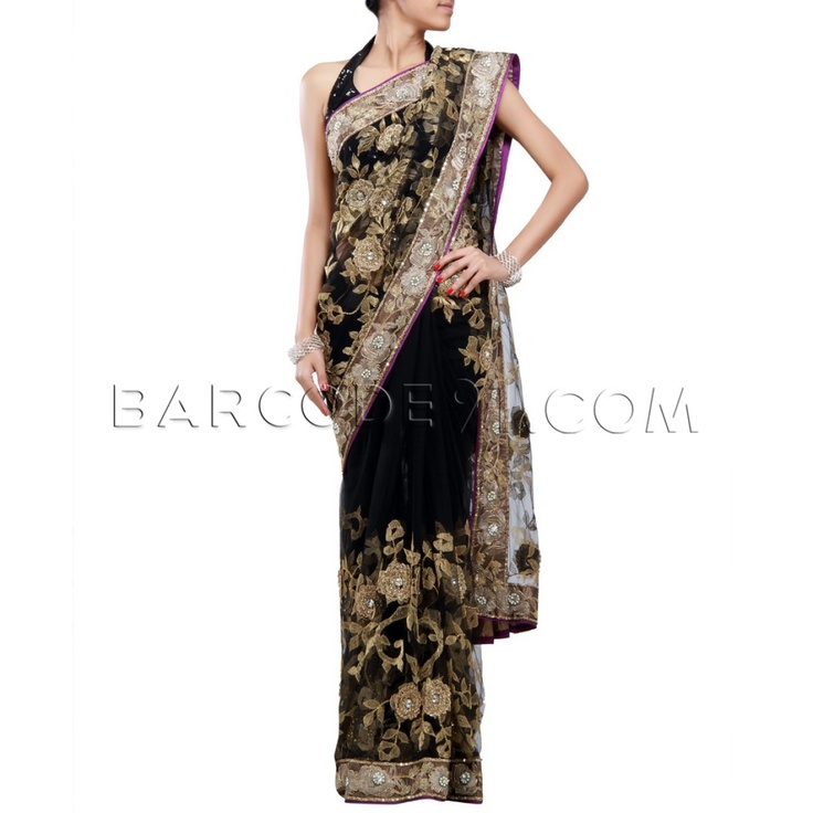 $287 Black net saree with floral zari work all over.It comes with net zari embroidered blouse piece.Slight variation is possible in color.
