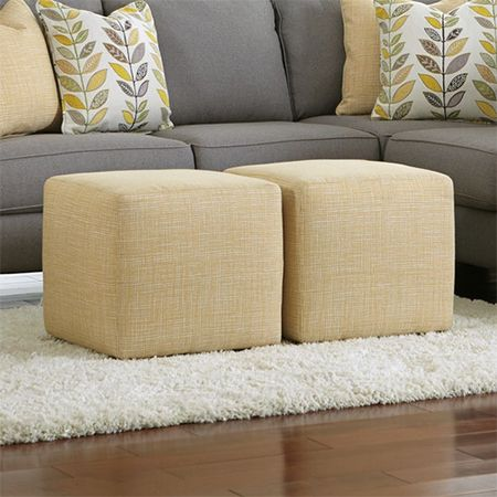 Make an upholstered cube ottoman - This upholstered cube has plastic feet that you can buy at most fabric stores and they cost around R1.00 each, but you can susbtitute this with any style of feet - or even leave off the feet if you prefer. http://www.easydiy.co.za/index.php/make/451-how-to-make-an-upholstered-cube-or-ottoman