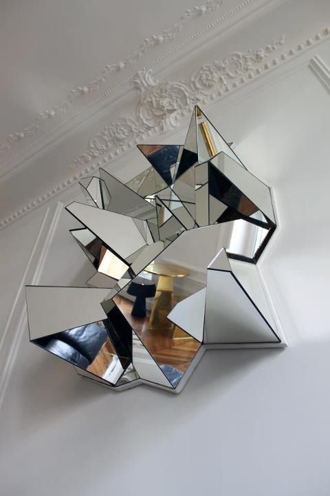 3d mirror, plaster, also note the GOLD table