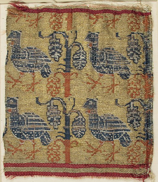Textile    Date:      13th century  Culture:      European  Medium:      Silk  Dimensions:      Overall: 7 1/4 × 6 3/16 in. (18.4 × 15.7 cm) Storage (Mat): 13 × 12 in. (33 × 30.5 cm)  Classification:      Textiles  Credit Line:      Fletcher Fund, 1946  Accession Number:      46.156.51    This artwork is not on display