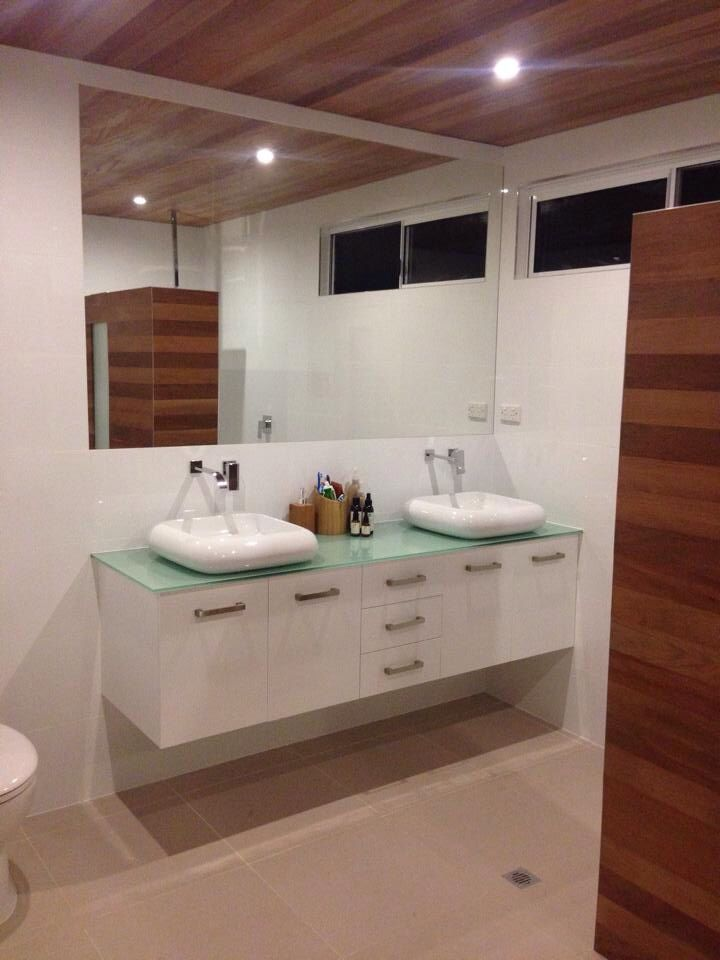 Bathroom with timber ceiling and shower panel