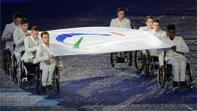 The Paralympic flag is carried by members of the Great Britain U22 Wheelchair Basketball team during the Opening Ceremony of the London 2012 Paralympics