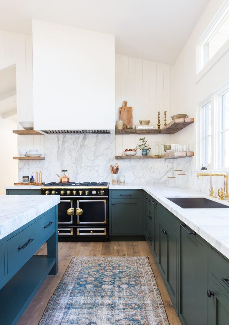 Blue kitchen cabinets with an beautiful oriental rug.