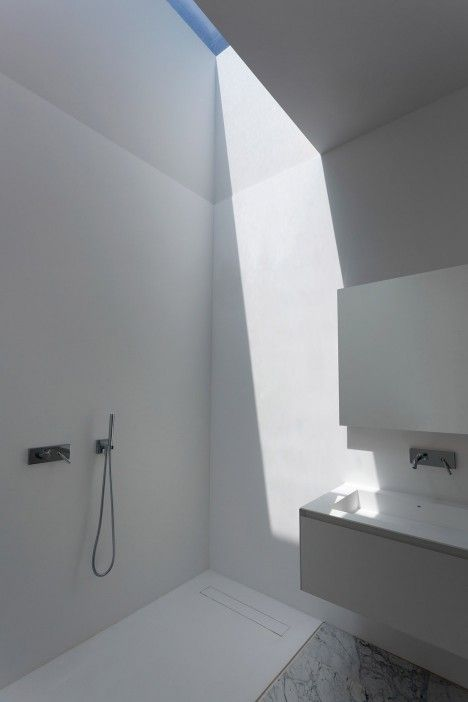 Skylights and atriums bring light into Aluminium House in Madrid by Fran Silvestre Arquitectos