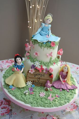 love the flowers and grass on this disney princess cake