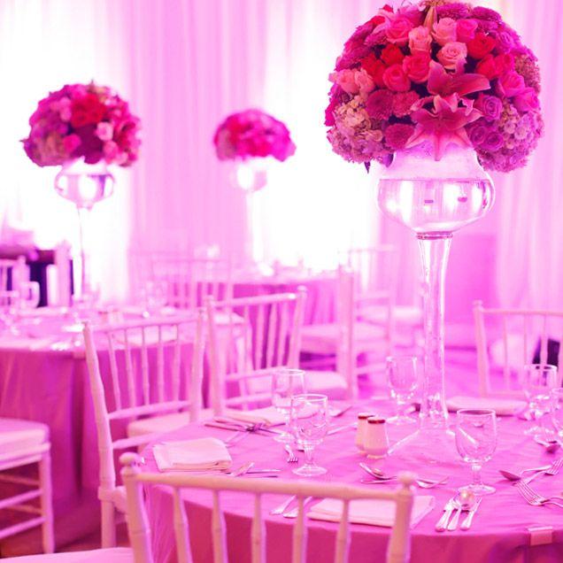 High pink floral centrepieces brighten this @Mandy Bryant Dewey Seasons Hotel Jakarta reception. @Mandy Bryant Dewey Seasons Bridal
