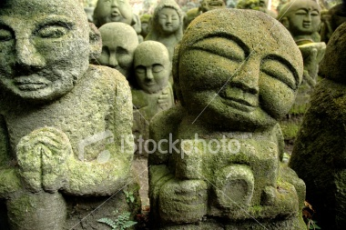 Moss covered statues at Arashiyama,  Kyoto,  Japan